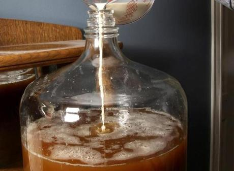 "After chilling the mixture, now called the ""wort,"" the mixture is transferred to the fermenter (a big glass jug) and then the yeast is added."